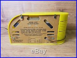 Yellow Art Deco Continental Model 1600 AM Tube Clock Radio. Needs restored